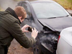 A man takes pictures of his car after a car accident in Las Vegas