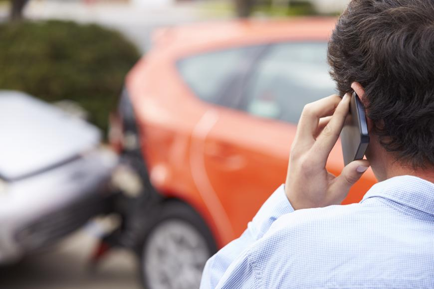 A Reno man calling his insurance company after a car accident.
