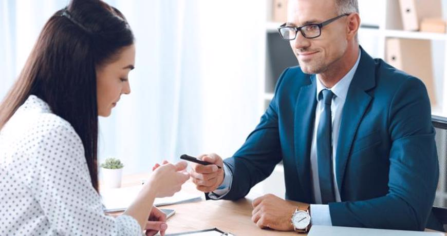 A woman meeting with a personal injury attorney.